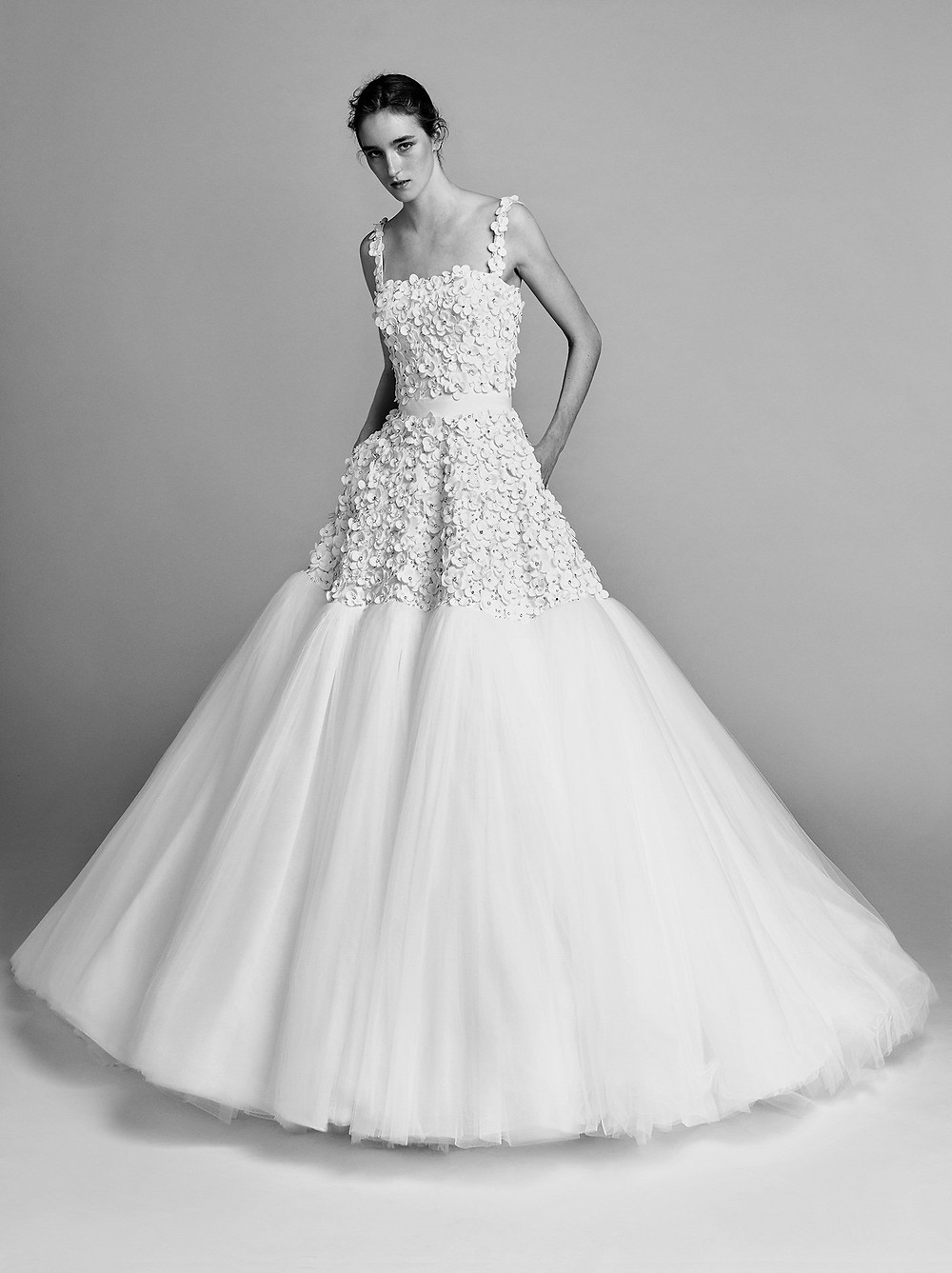 A Viktor & Rolf tulle ball gown wedding dress with pockets and flowers