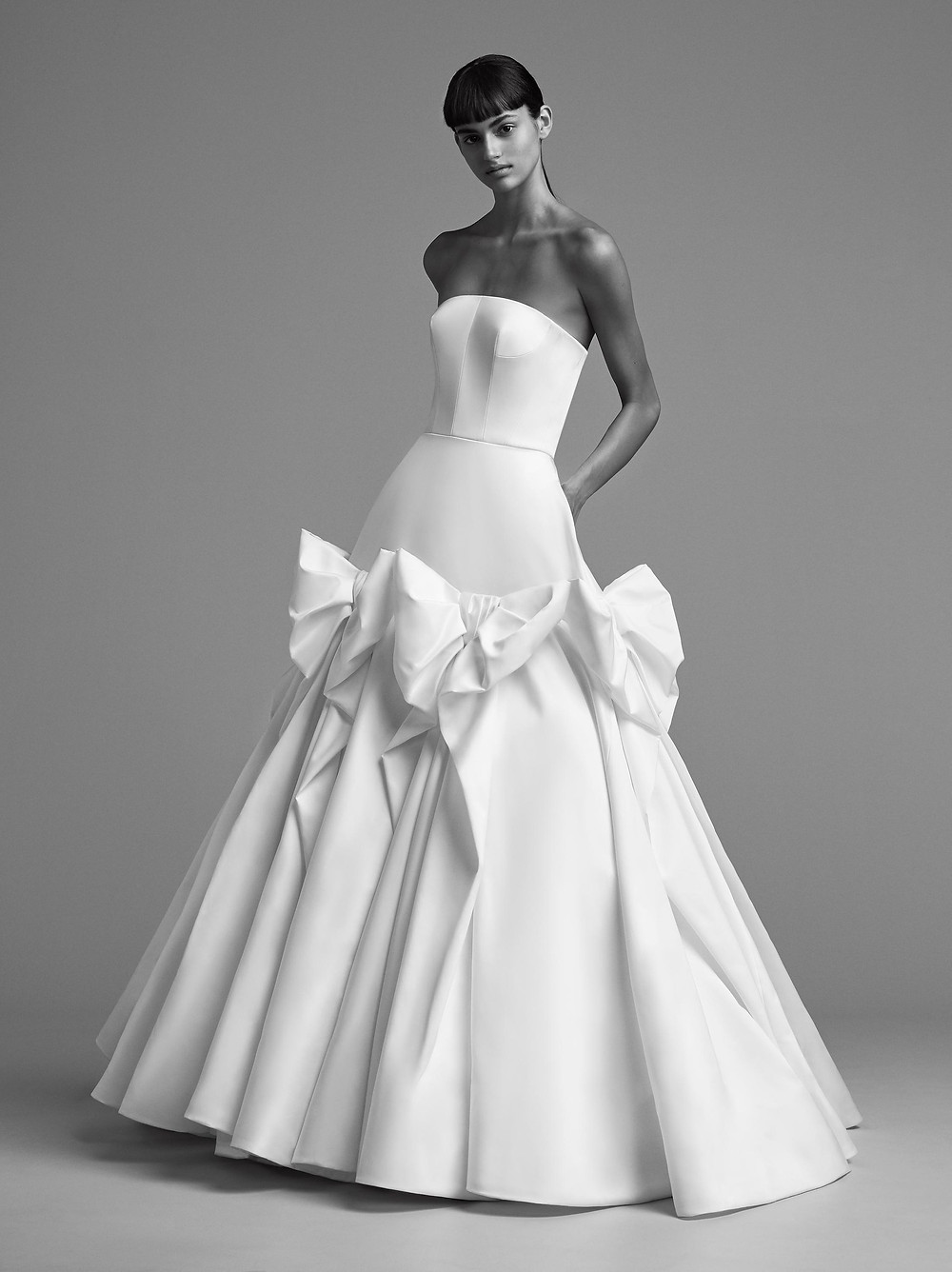 A Viktor & Rolf simple strapless crepe ball gown wedding dress with bows