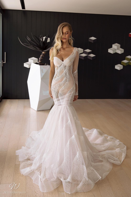 A Tina Valerdi chiffon one shoulder mermaid wedding dress with a ruffle skirt and illusion bodice