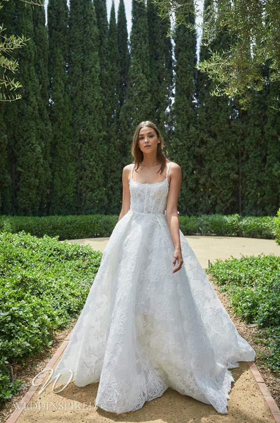 A Monique Lhuillier lace princess ball gown wedding dress with thin straps