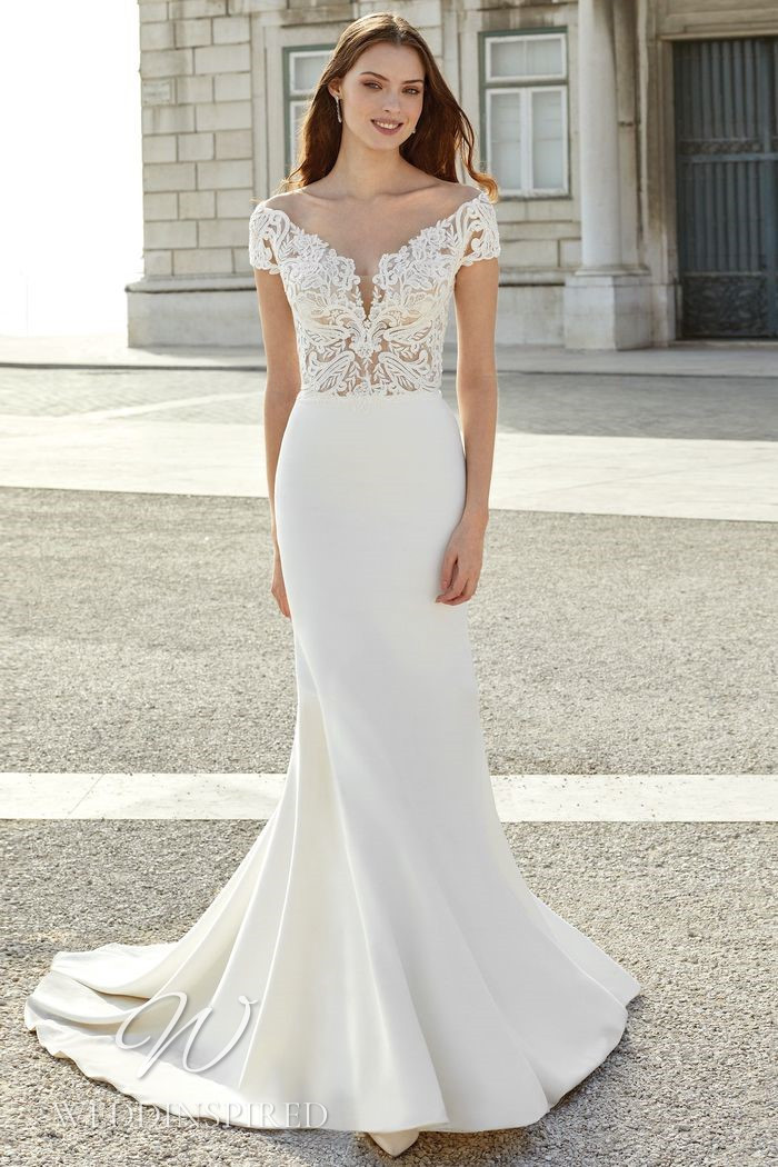 A Justin Alexander 2021 lace and satin off the shoulder mermaid wedding dress