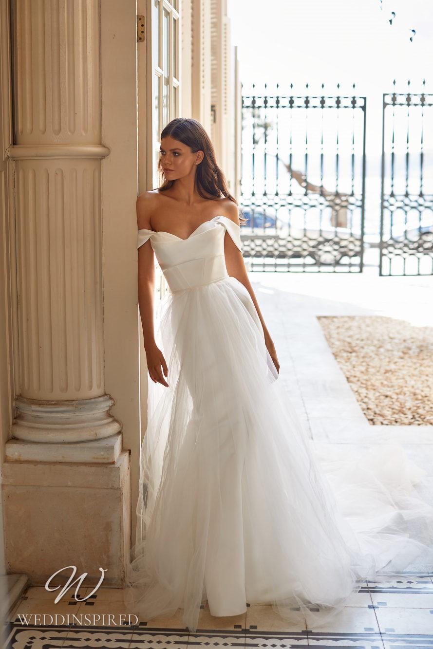 A Milla Nova 2021 off the shoulder satin and tulle mermaid wedding dress
