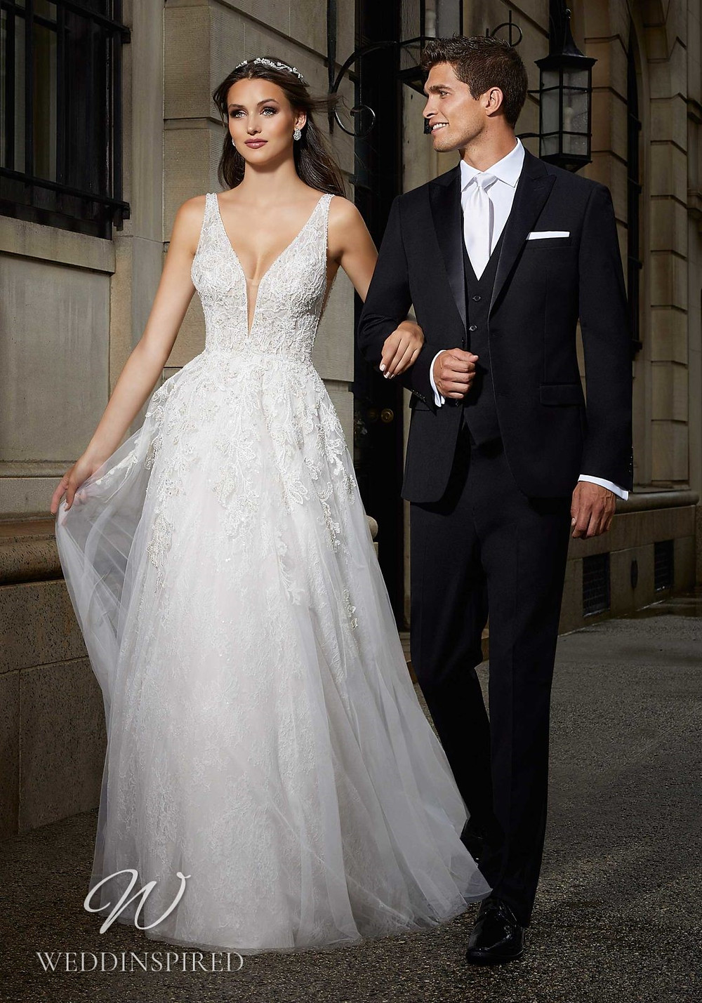 A Madeline Gardner lace A-line wedding dress with a v neckline