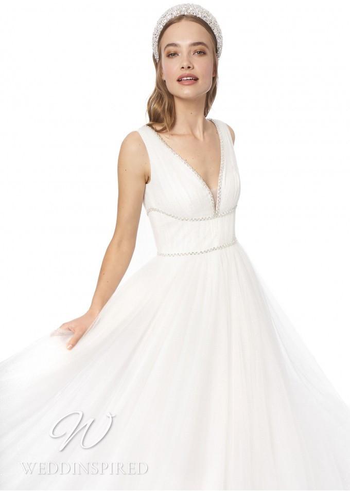 A Jenny Packham 2021 tulle A-line wedding dress with a v neckline