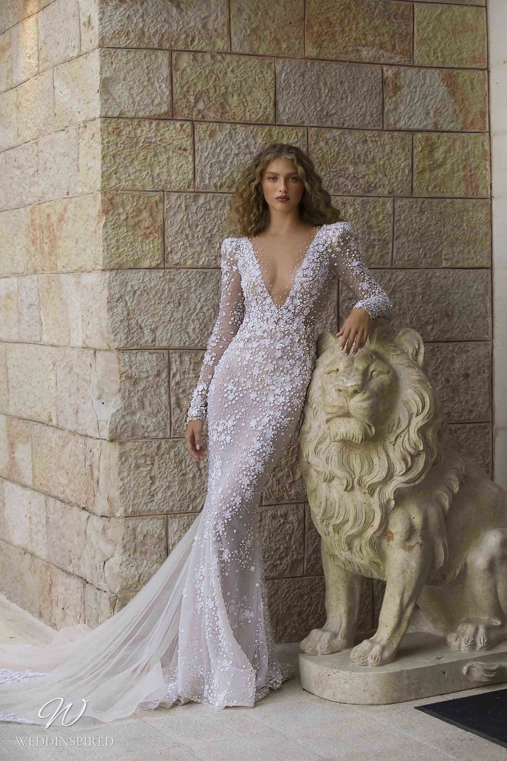 A Berta Colony 2021 lace and tulle mermaid wedding dress with long illusion sleeves and a low v neckline