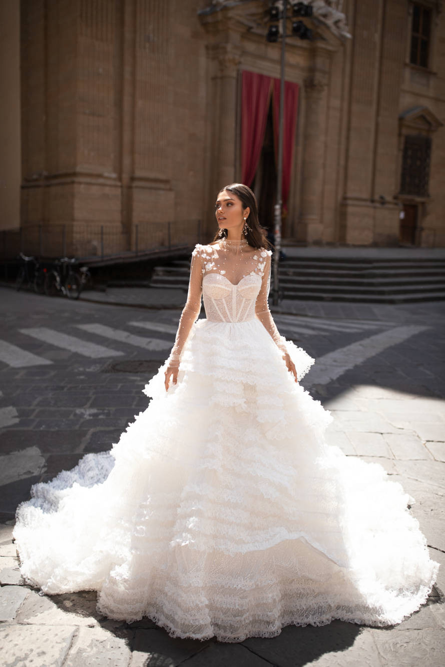 A Milla Nova ball gown wedding dress with a layered tulle skirt, a sweetheart neckline and an illusion top