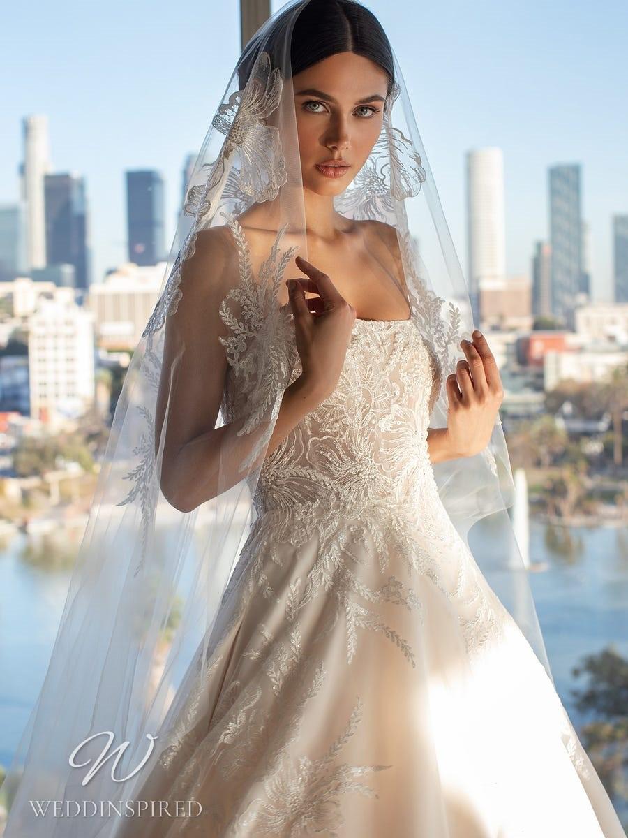 A Pronovias 2021 blush lace A-line wedding dress with straps