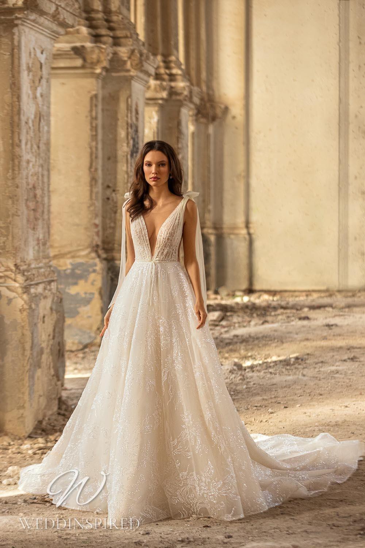 An Eva Lendel 2021 tulle A-line wedding dress with a v neck