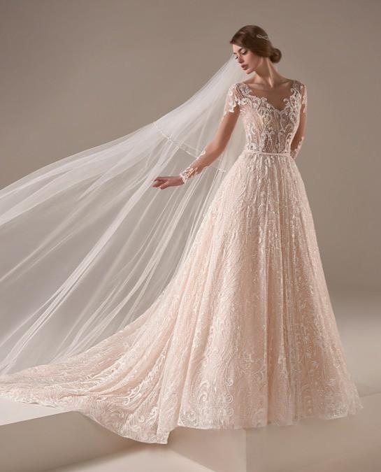 A Pronovias blush pink romantic sparkly ball gown wedding dress