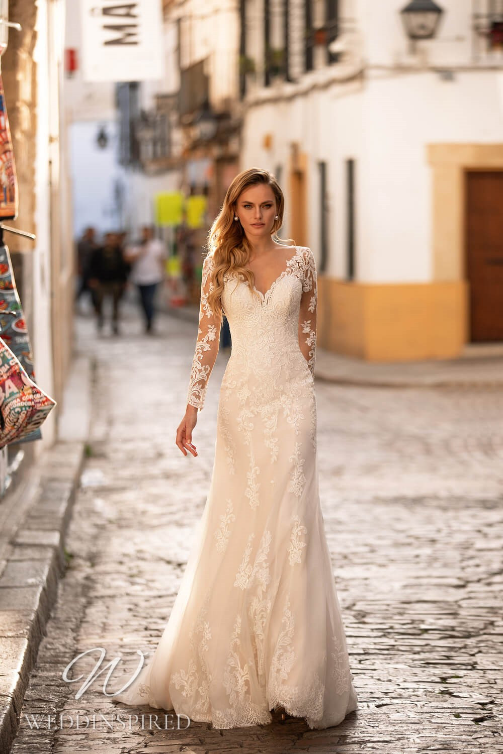 An Essential by Lussano 2021 lace sheath wedding dress with long sleeves