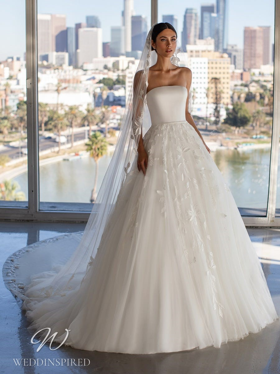 A Pronovias 2021 strapless satin and tulle ball gown wedding dress