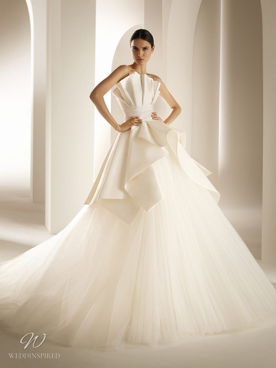 An Atelier Pronovias strapless ball gown wedding dress with a pleated skirt and a ruffle bodice