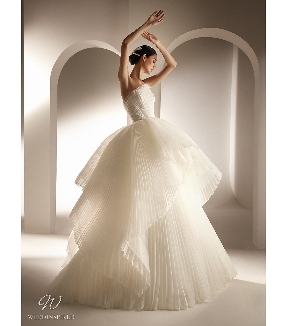 An Atelier Pronovias strapless pleated chiffon ball gown wedding dress with a ruffle skirt