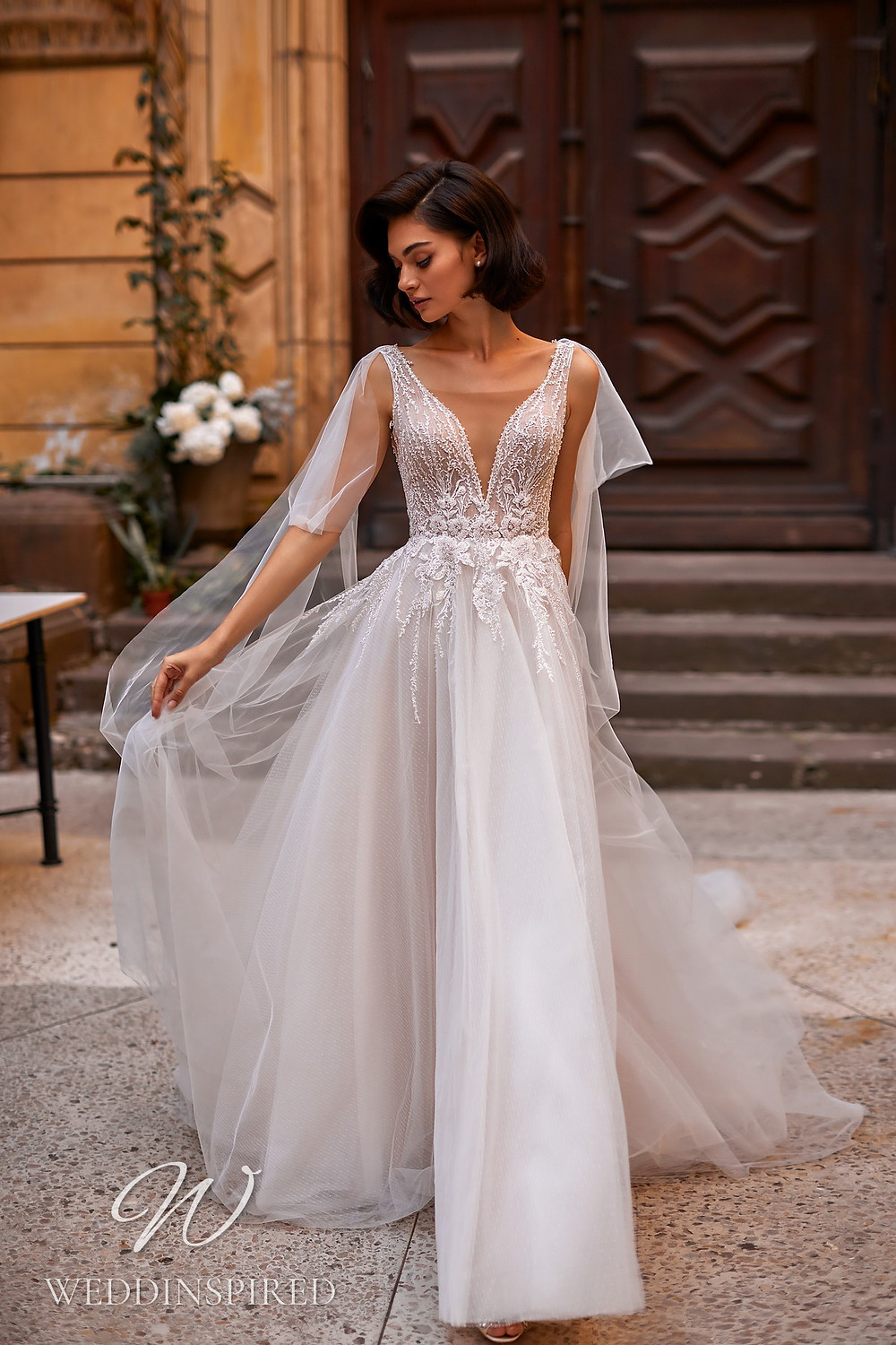 A Daria Karlozi 2021 tulle A-line wedding dress with a v neck