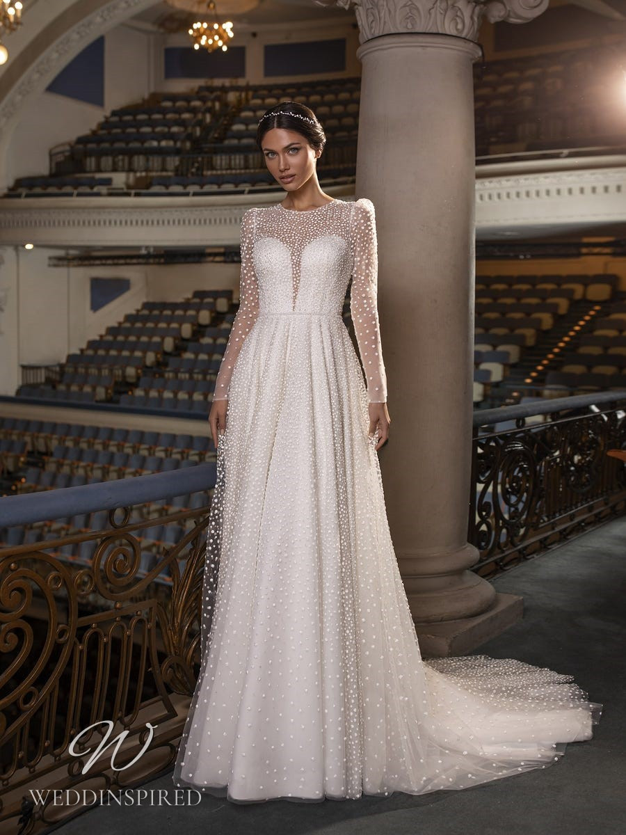 A Pronovias Privée 2021 satin and tulle A-line wedding dress with long sleeves and pearl details