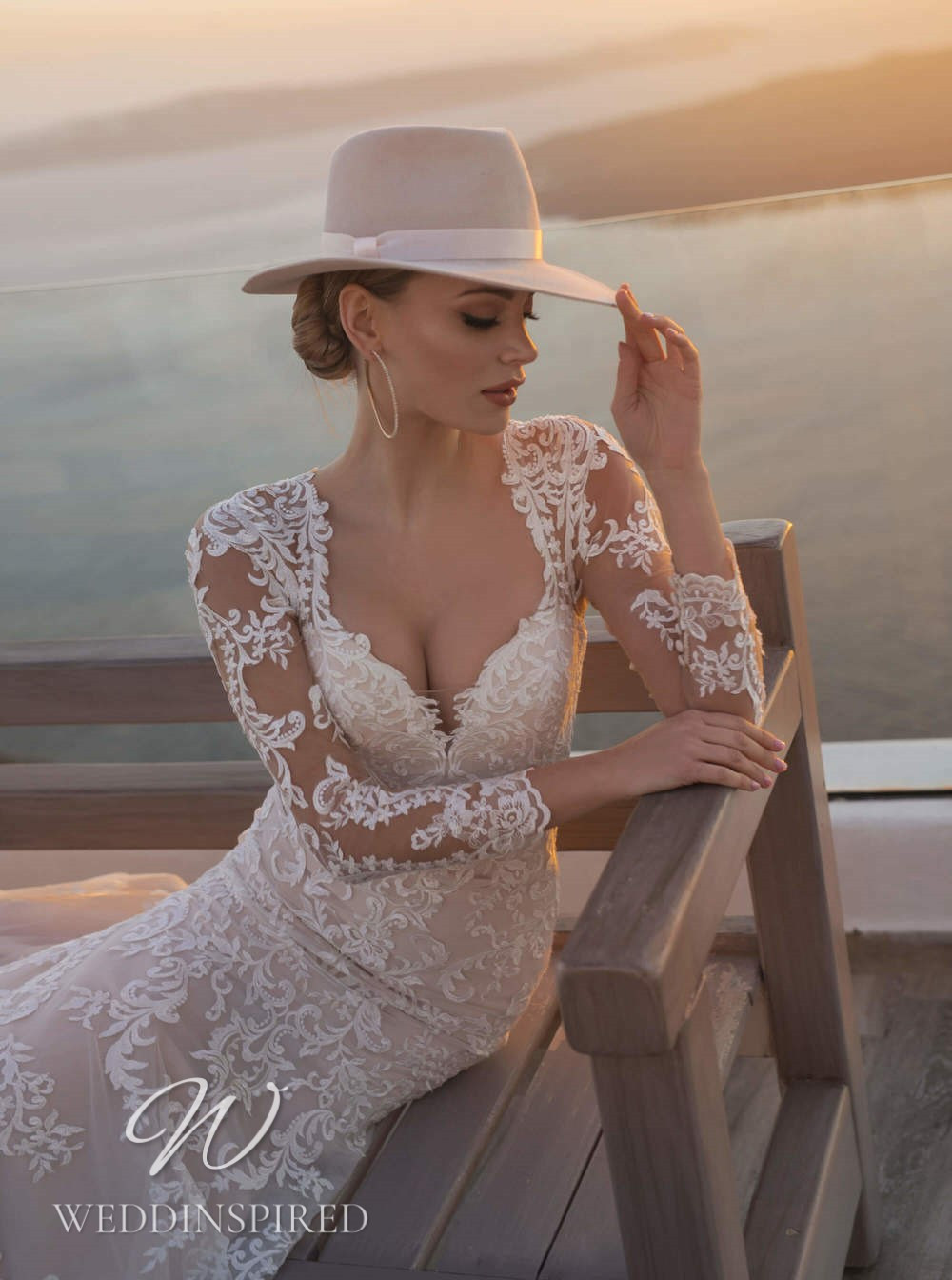 A Blunny 2021 lace mermaid wedding dress with long sleeves