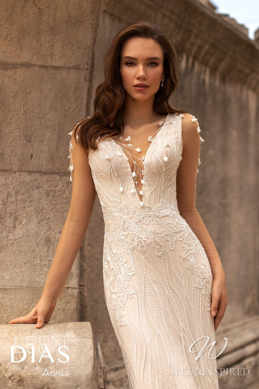 A Leen Dias 2021 lace mermaid wedding dress with a v neck