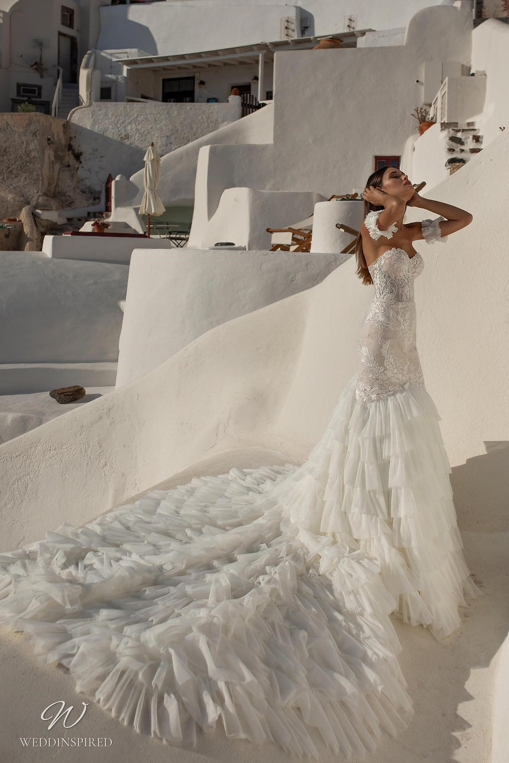 A Ricca Sposa lace mermaid wedding dress with a tulle ruffle skirt and a train