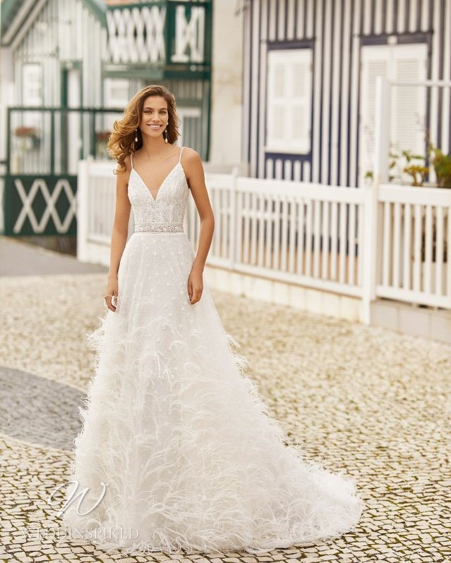A Rosa Clara 2021 lace and feathers A-line wedding dress