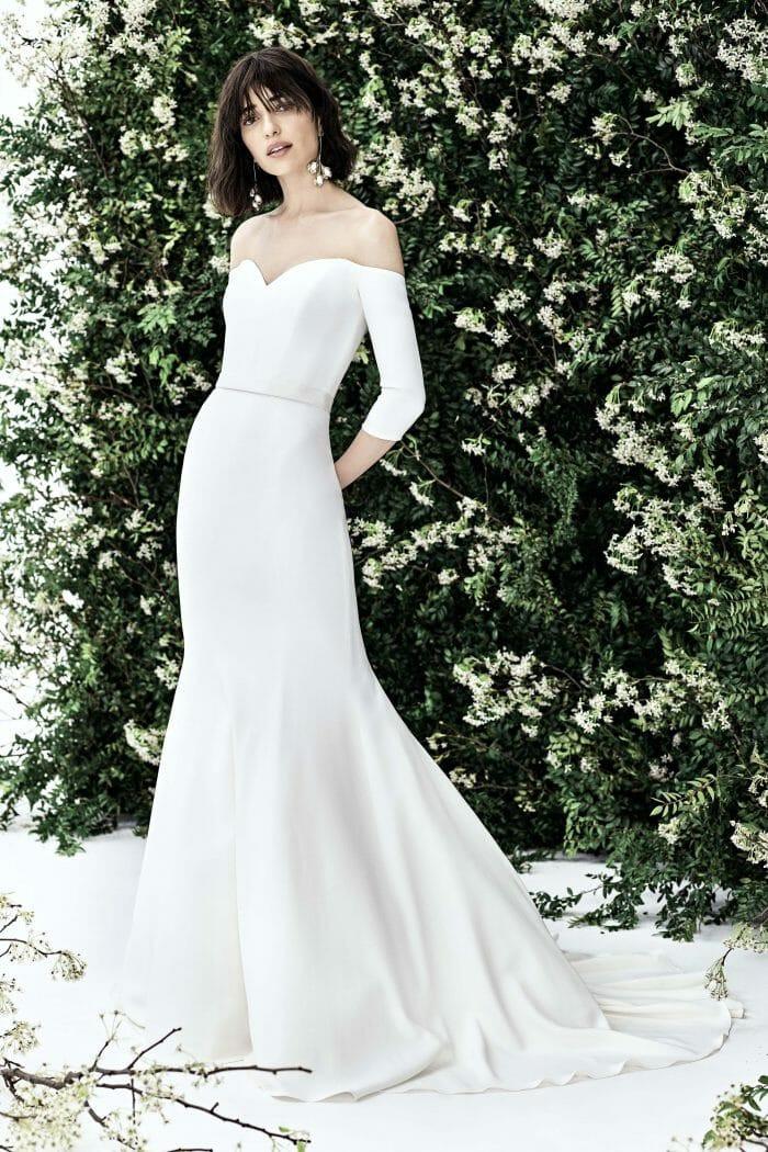 A Carolina Herrera 3/4 sleeve, mermaid wedding dress, with sweetheart neckline