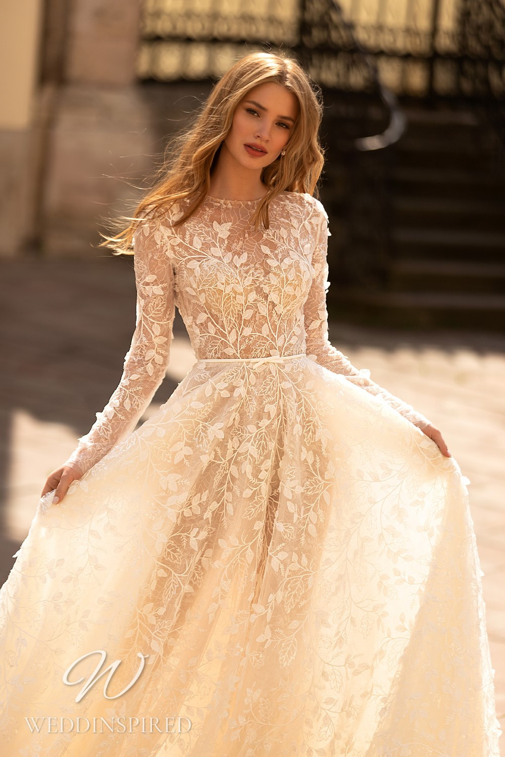 A WONÁ Concept 2021 blush lace A-line wedding dress with long sleeves
