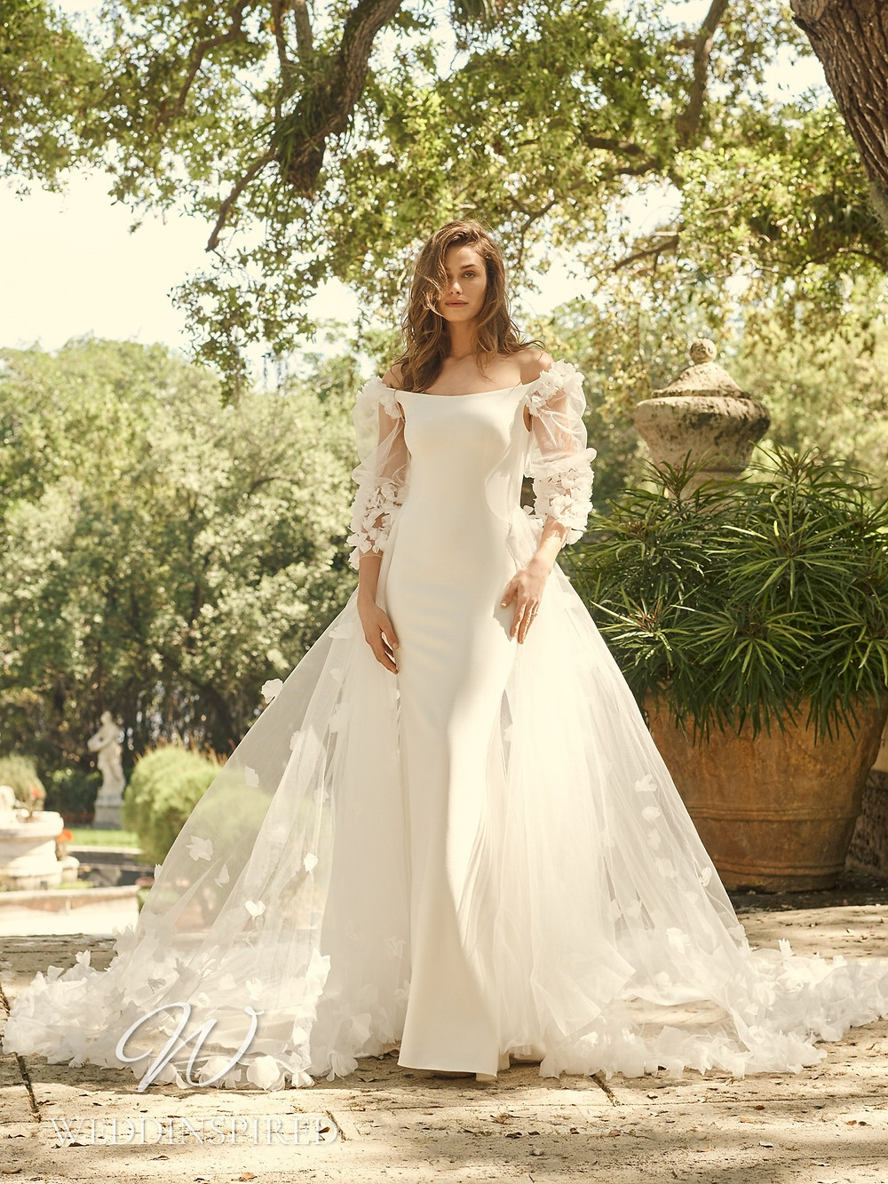 A Maggie Sottero 2021 satin mermaid wedding dress with tulle detachable skirt