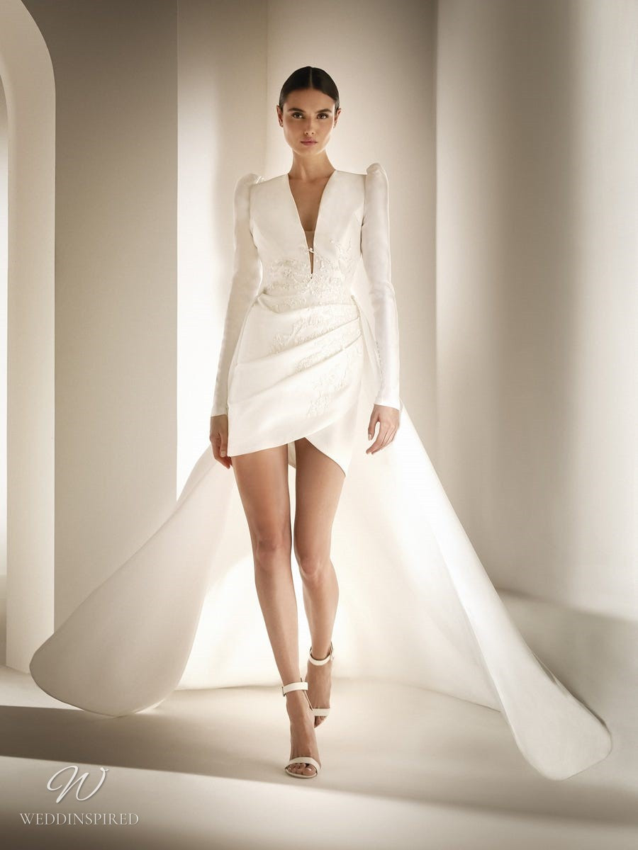 An Atelier Pronovias short wedding dress with long sleeves and a cape