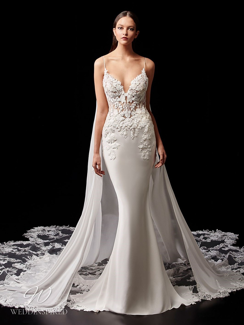 An Enzoani lace and silk mermaid wedding dress with a cape and a long illusion train