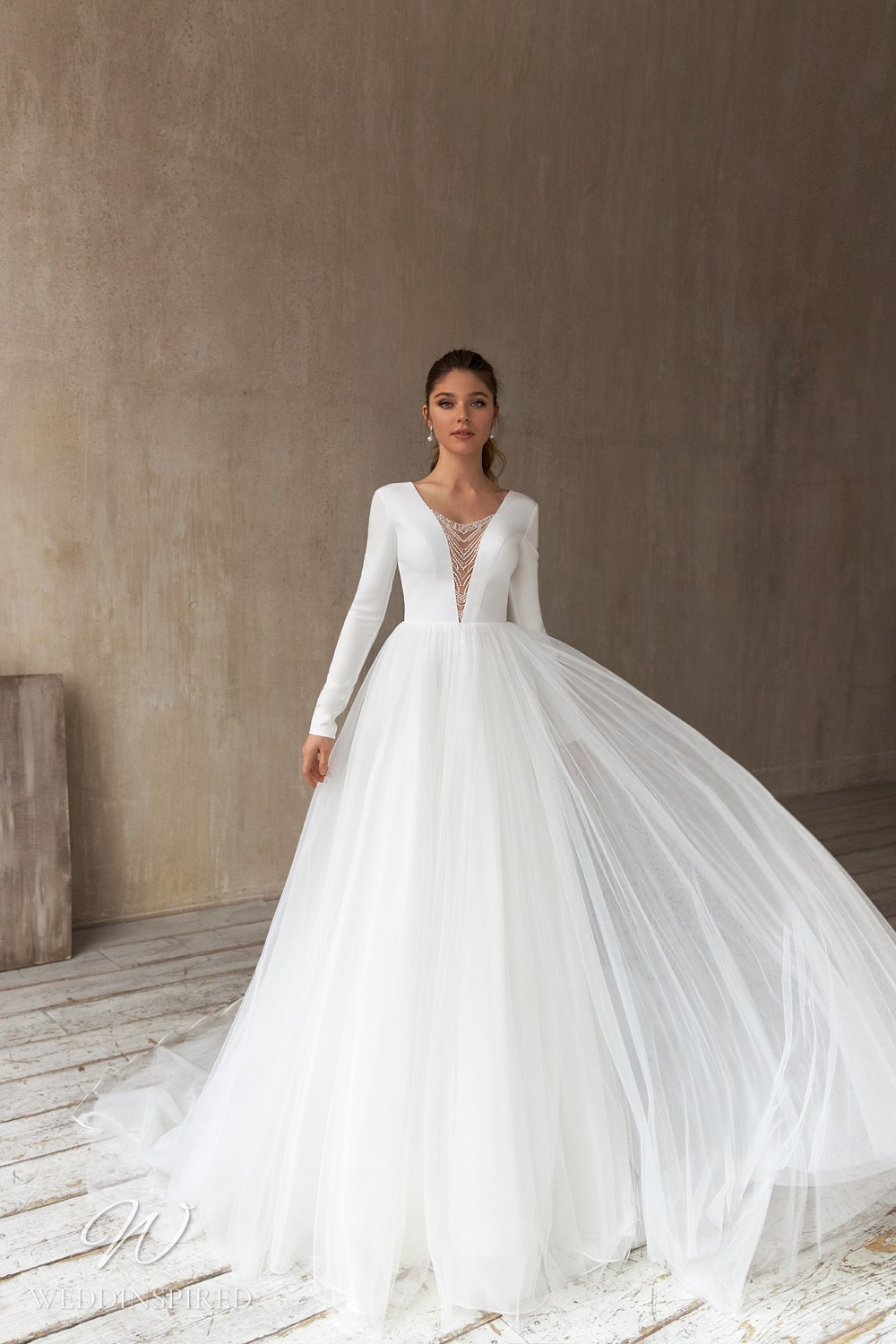 An Eva Lendel 2021 crepe and tulle ball gown wedding dress with long sleeves