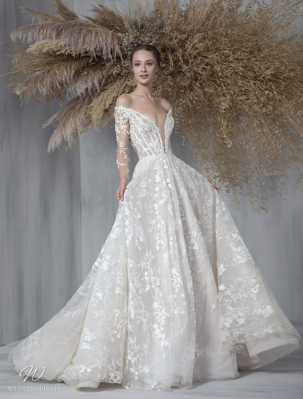 A Tony Ward 2021 lace off the shoulder A-line wedding dress with long sleeves and a v neck
