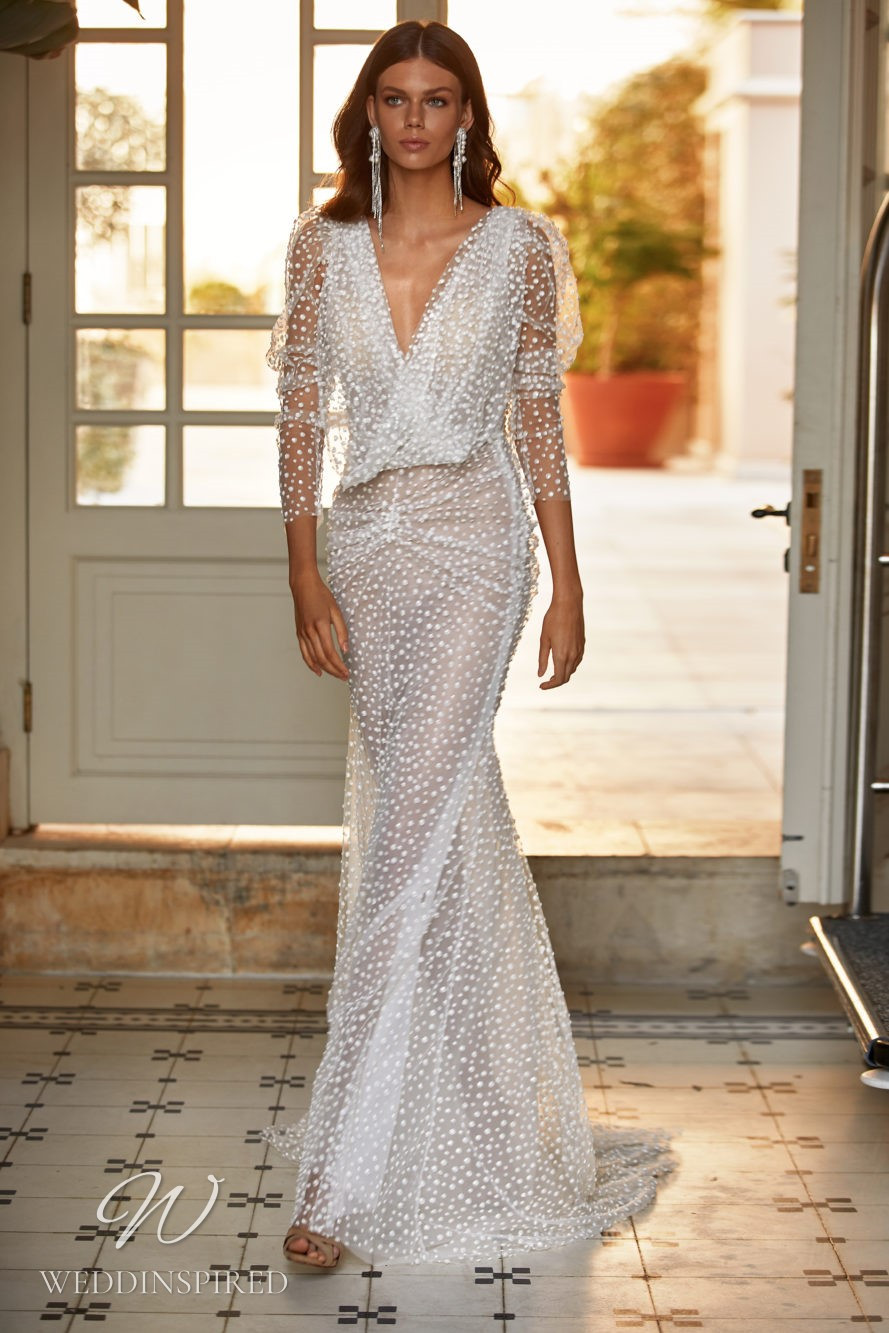 A Milla Nova 2021 sparkly tulle mermaid wedding dress with long sleeves and a v neck