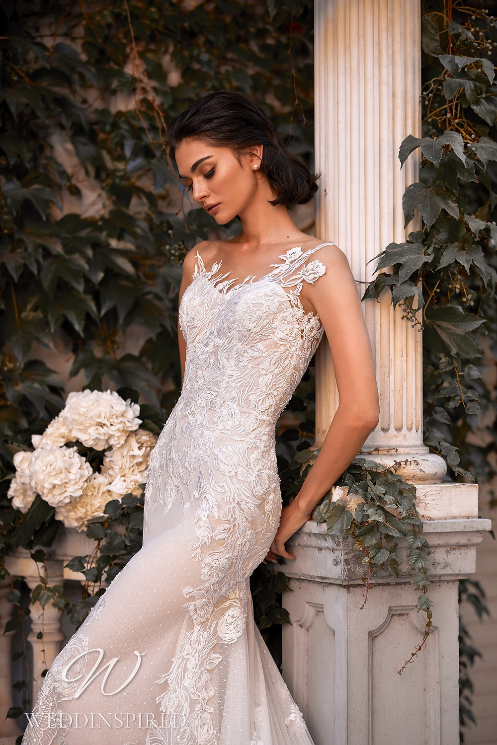 A Daria Karlozi 2021 lace and tulle mermaid wedding dress