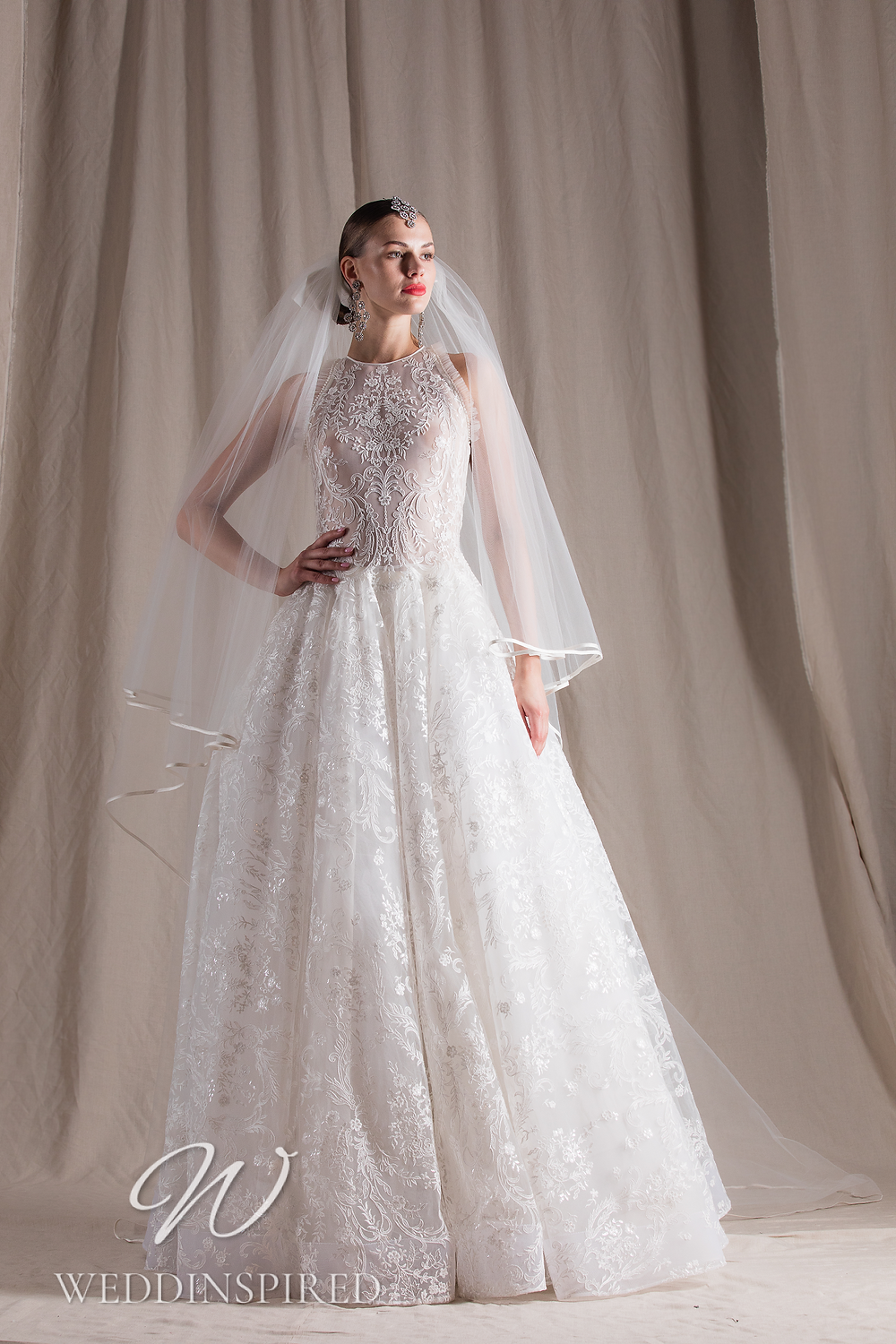 A Naeem Khan 2022 lace and tulle A-line wedding dress