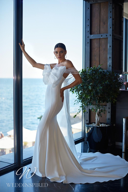 An Ida Torez 2021 satin mermaid wedding dress with a bow