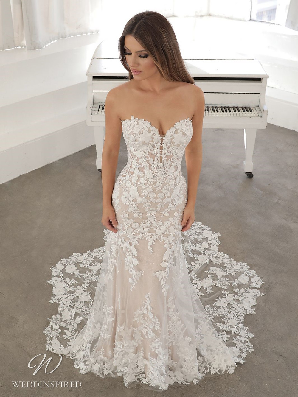 A Blue by Enzoani 2021 strapless lace mermaid wedding dress with a train