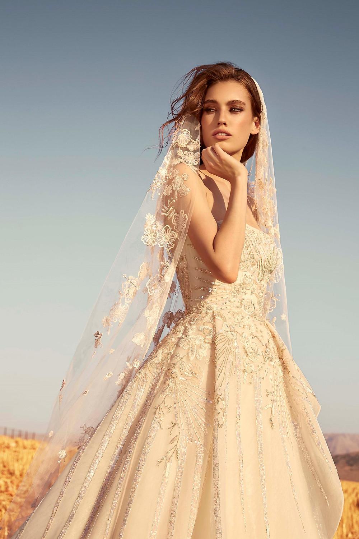 A Zuhair Murad blush peach romantic ball gown wedding dress