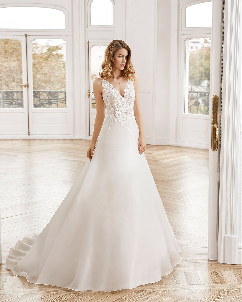 An Aire Barcelona 2020 lace and chiffon A-line wedding dress with a v neckline