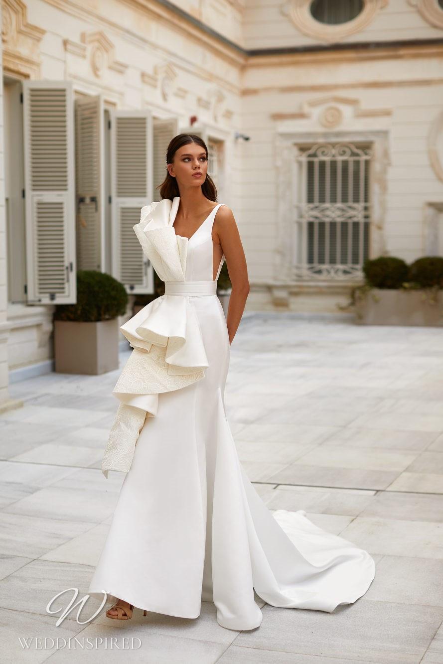 A Milla Nova 2021 satin mermaid wedding dress with straps and ruffle detail