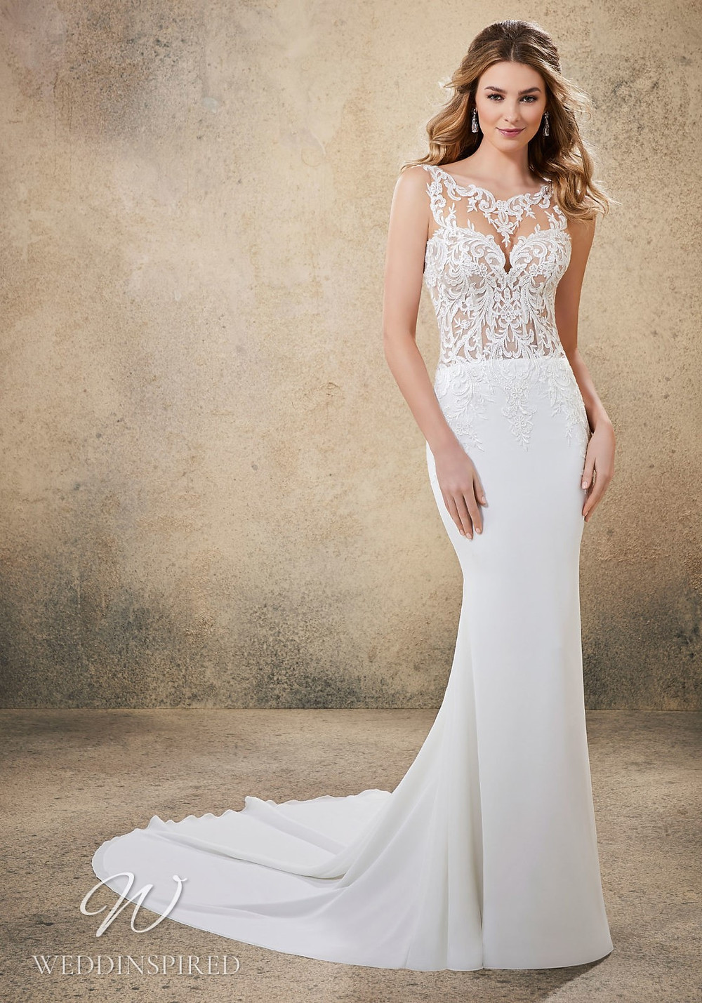 A Madeline Gardner lace and crepe mermaid wedding dress