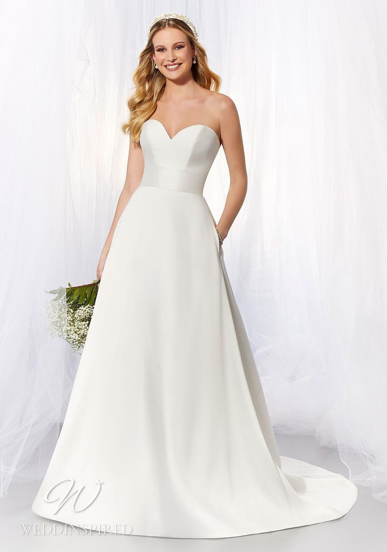 A Madeline Gardner simple strapless satin A-line wedding dress