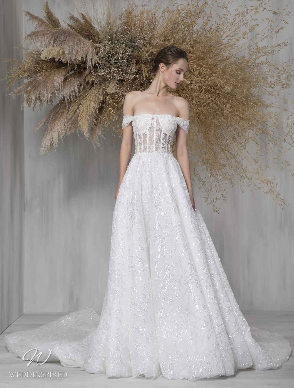 A Tony Ward 2021 off the shoulder sparkly A-line wedding dress with a train