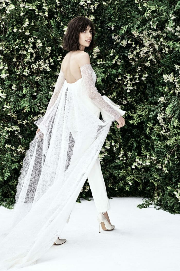 A Carolina Herrera lace wedding jumpsuit or pantsuit with long sleeves