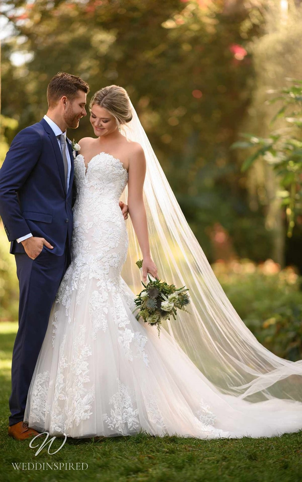 An Essense of Australia strapless lace and tulle mermaid wedding dress