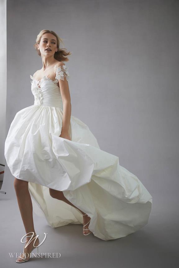 An Oscar de la Renta 2022 off the shoulder lace and taffeta ball gown wedding dress