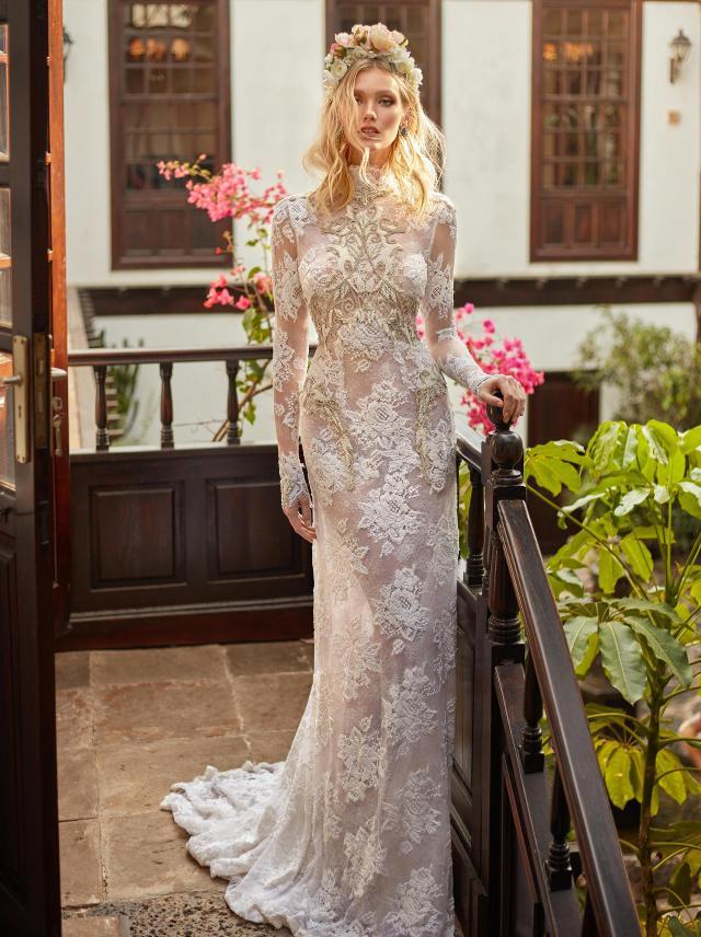 A Galia Lahav modest ivory lace mermaid wedding dress with long sleeves