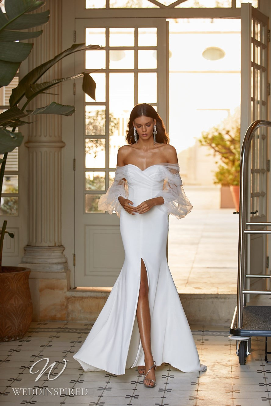 A Milla Nova 2021 tulle and satin off the shoulder mermaid wedding dress with a slit