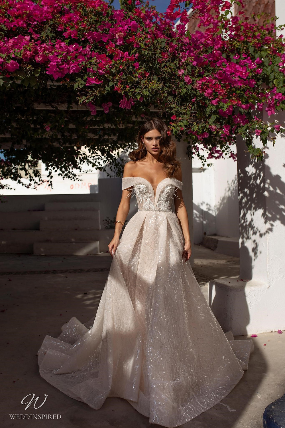 A Ricca Sposa off the shoulder sparkly ball gown wedding dress with a sweetheart neckline