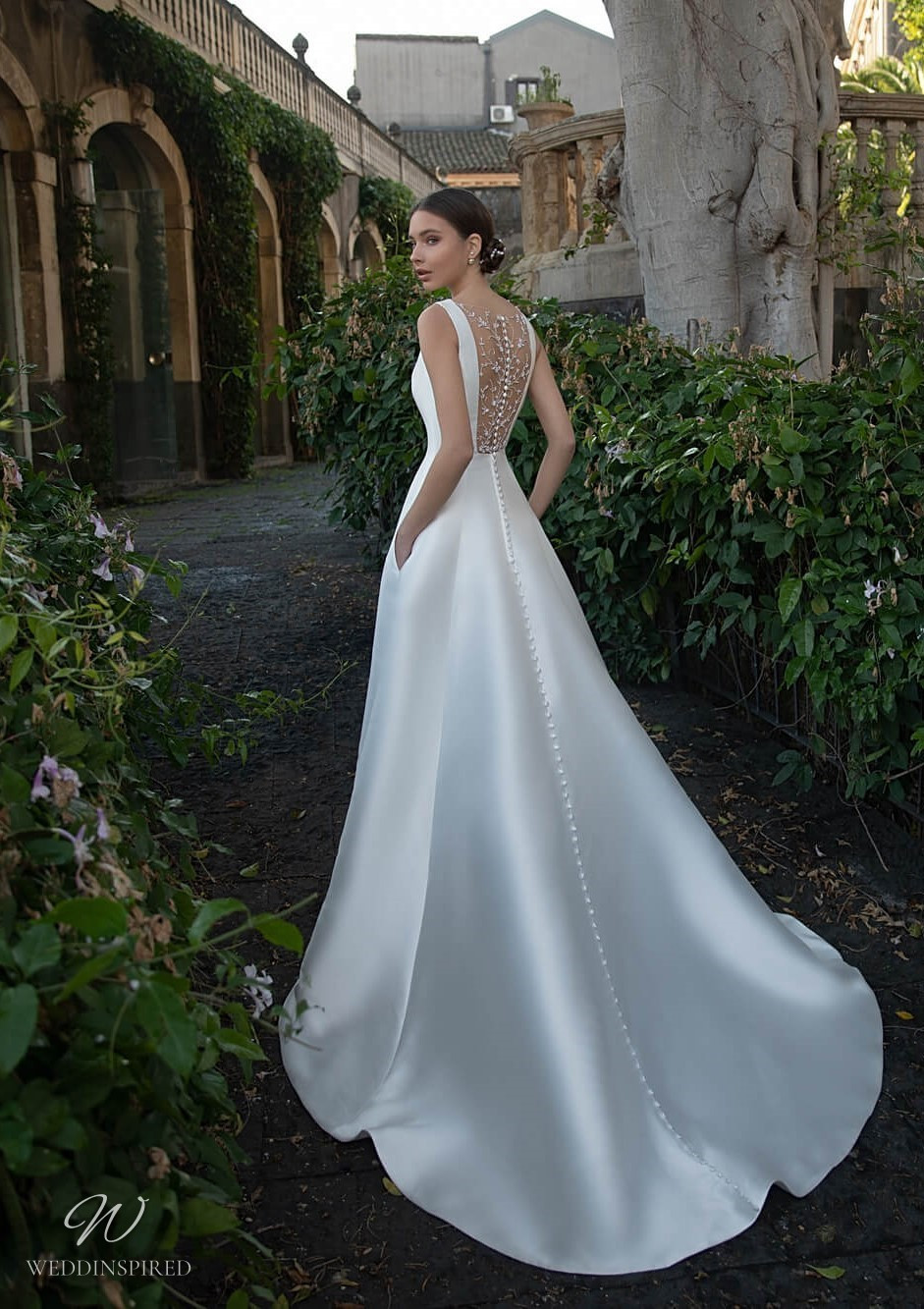 A Naviblue silk satin A-line wedding dress with straps and an illusion back