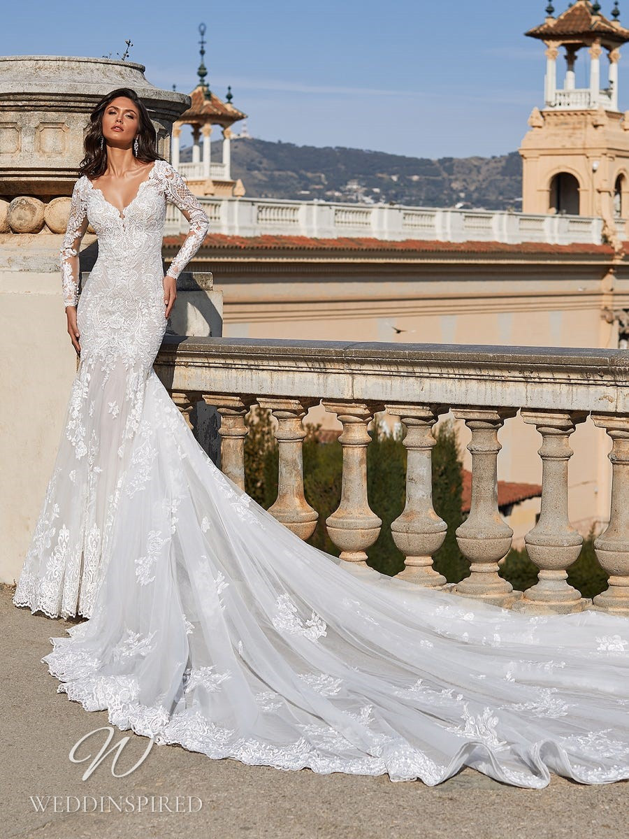 A Pronovias Privée 2021 lace mermaid wedding dress with long sleeves, a v neck and a train
