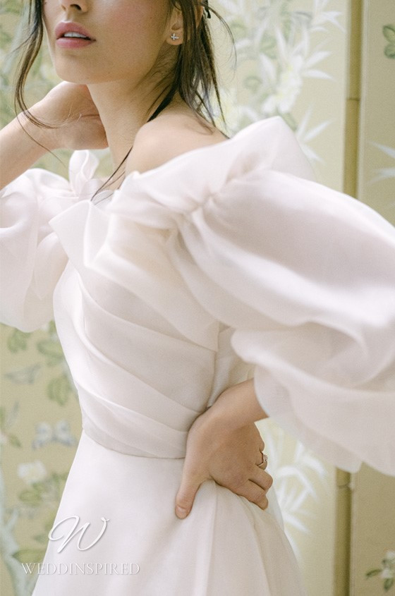 A Monique Lhuillier Fall 2021 soft flowy blush mesh A-line wedding dress